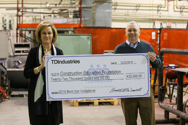 CEF President/Executive Director Jane Hanna (left) and Chairman of the Board Chris Peck (right) accept the check from TD.